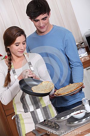 Cute couple making crepes