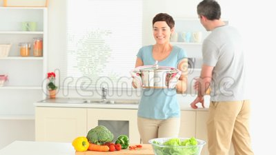 Cute Couple preparing lunch Stock Photo