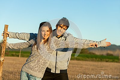 Cute couple stretching arms outdoors.