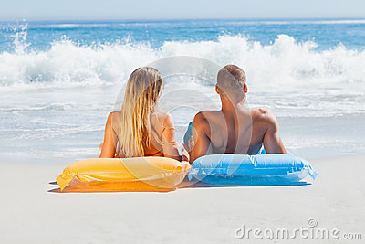 Cute couple in swimsuit sunbathing together