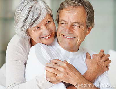 Cute elderly couple hugging each other
