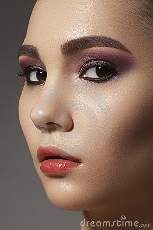 Cute face with shiny clean skin & fashion make-up