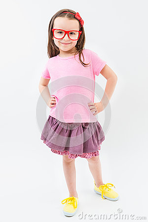 Free Cute Fashion-monger Girl In Pink Dress Tshirt And Skirt Red Glasses Frames. Stock Photos - 71804633