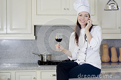 Cute female chef taking a break