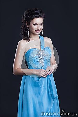 Cute female in fashionable vogue blue dress