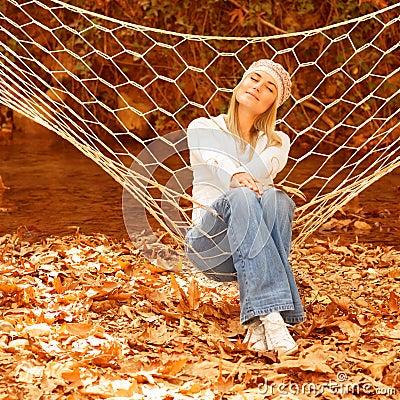Cute female in sitting in hammock