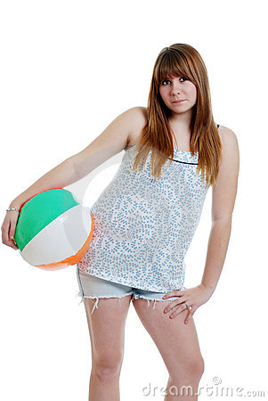Cute female teenager with a beach ball