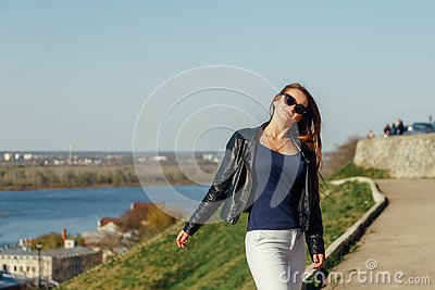 Cute funny girl playing monkey on camera Girl confused Stock Photo
