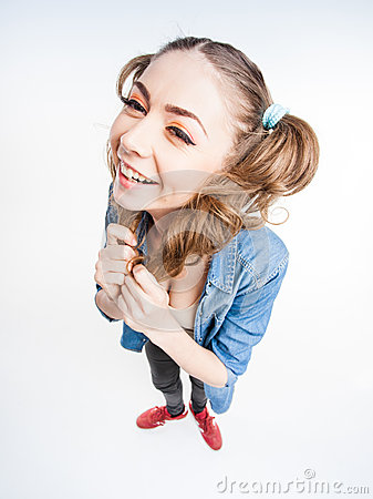 Cute funny girl with two pony tails smiling - wide angle