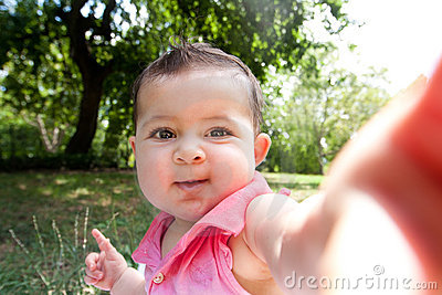 Cute funny happy baby face selfie