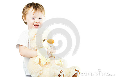 Cute funny infant baby girl with big toy bear