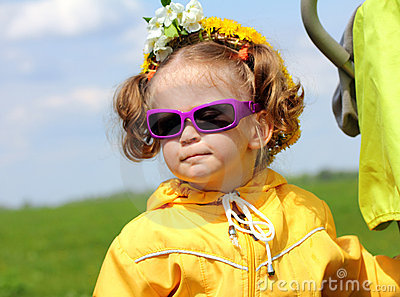 Cute funny little girl in sunglasses