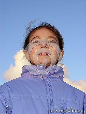 Cute girl against the sky
