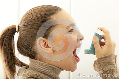 Cute girl with asthma inhalator