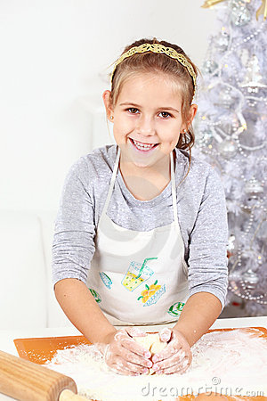 Cute girl baking cookies