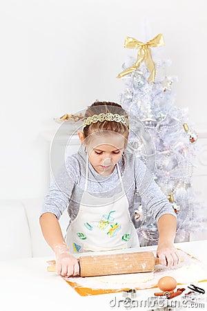 Cute girl baking cookies