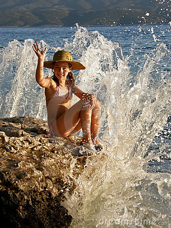 Girl in breaking waves
