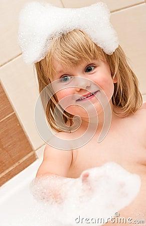 Cute girl in bubble bath