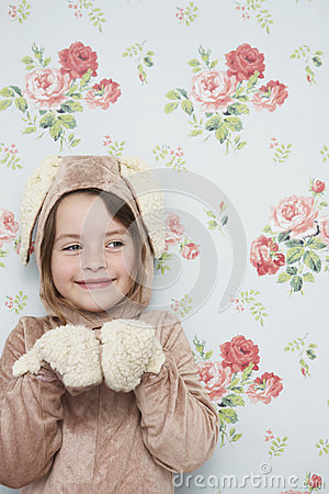 Cute Girl In Bunny Costume Against Wallpaper