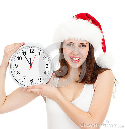 Cute girl in Christmas red santa hat with clock