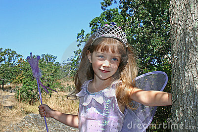 Cute girl with crown and wings