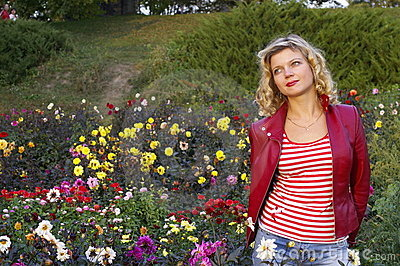 Cute girl on dahlia flowers meadow