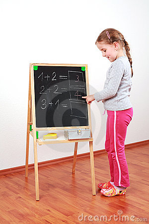 Cute girl doing math