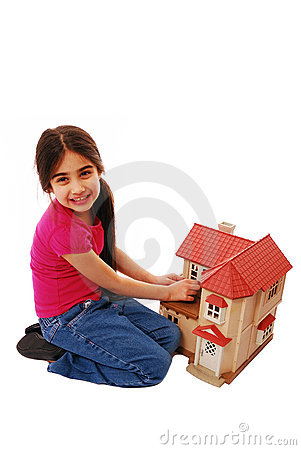 Cute girl with dolls house