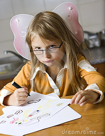 Cute girl drawing pictures