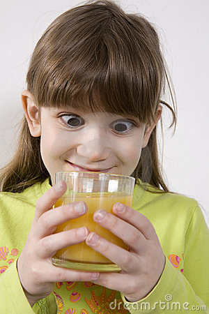 cute girl drink orange juice