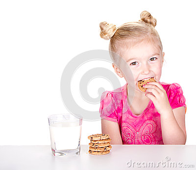 Cute girl eating a chocolate chip cookie
