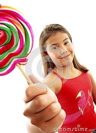 Cute girl eating lollipop