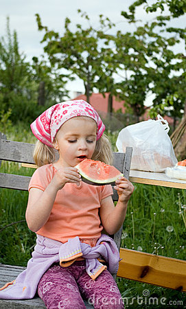 Cute girl eating watermelon