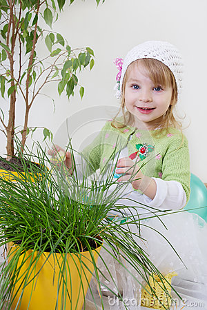 Girl enjoying green plants at spring