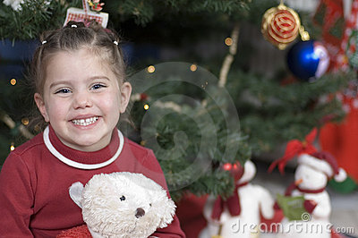 Cute girl in front of Christmas tree