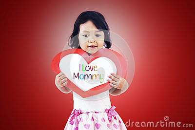 Cute girl give love card to mom