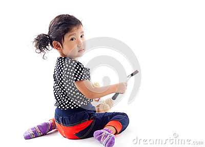 Cute girl with hammer and doll