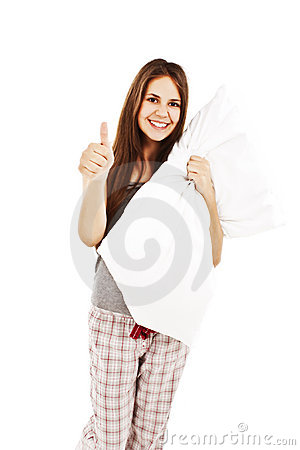 Cute girl in her pajamas holding a pillow