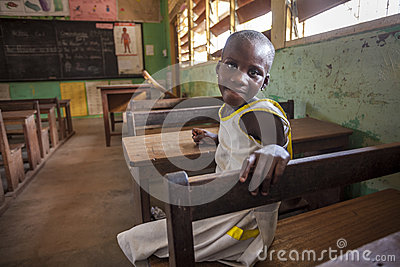 Cute girl at her school in Africa Editorial Photography