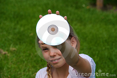 Cute girl holding CD