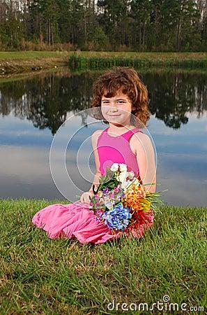 Cute girl holding flower bouqet