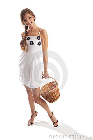 Cute girl holding fruit basket