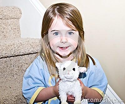 Cute Girl Holding Stuffed Animal