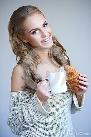 Cute girl holding white cup