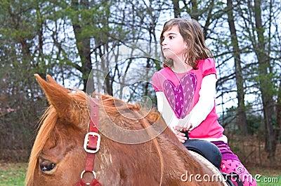 Cute Girl on a Horse