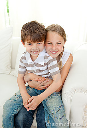 Cute girl hugging her little brother