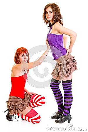 Cute girl on knees beging her girlfriend