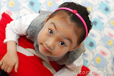 Cute girl look up with a smile.