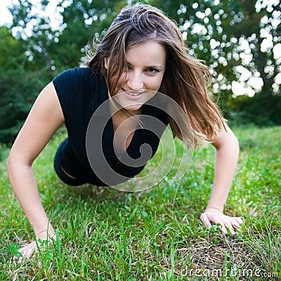 Cute girl makes pushups