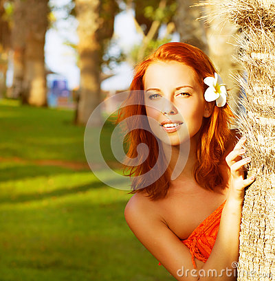 Cute girl near palm tree